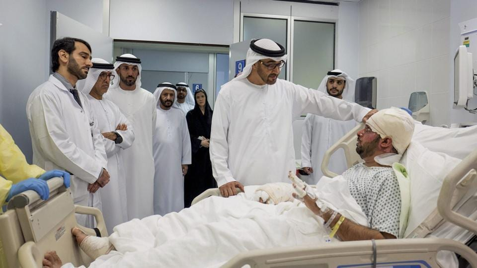 In this Saturday, Jan. 14, 2017, file photo released by Emirates News Agency, WAM, Sheikh Mohamed bin Zayed Al Nahyan Crown Prince of Abu Dhabi and Deputy Supreme Commander of the UAE Armed Forces, visits Juma Al Kaabi, the UAE Ambassador to Afghanistan, who was injured in the Kandahar terrorist attack at Al Mafraq hospital in Abu Dhabi, United Arab Emirates.