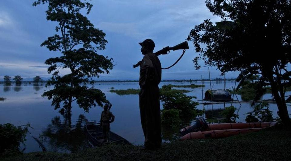 A forest guard keeps vigil at the flooded Kaziranga National Park, east of Gauhati, northeastern Assam state, in this file photo from July 2016.