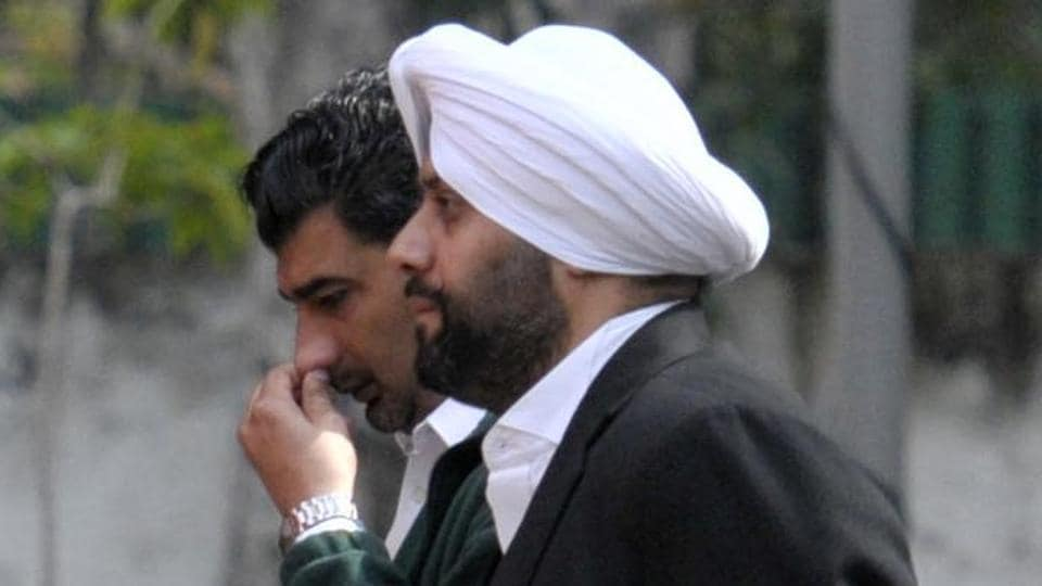 Shera Singh (right) and Deep Sidhu (rubbing his nose), friends of Akansh Sen, were called for questioning at the Sector-3 police station on Tuesday.
