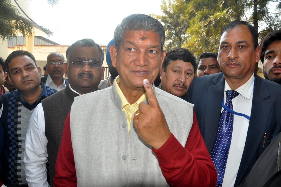 Chief minister Harish Rawat  poses for shutterbugs outside a polling booth in Dehadun  on Wednesday.