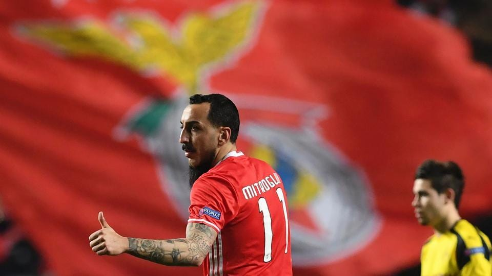 Benfica's Greek forward Konstantinos Mitroglou (left) celebrates after scoring against Borussia Dortmund during their UEFA Champions League round of 16 first leg match at the Luz Stadium in Lisbon on Tuesday.