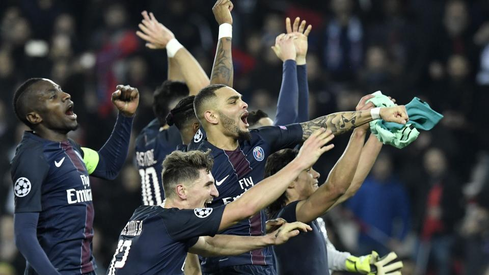 (From left) Paris Saint-Germain FC (PSG) players celebrate after beating FC Barcelona in their UEFA Champions League round of 16 first leg match on Tuesday.
