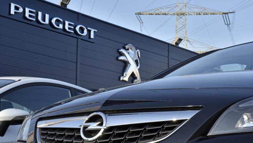 France's PSA Group, maker of Peugeot and Citroen cars, says it's exploring a takeover of Opel, General Motors' money-losing European business.