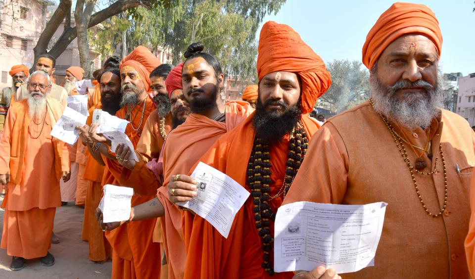 Sadhus wait for their turn to vote at  a polling booth in Haridwar on Wednesday.