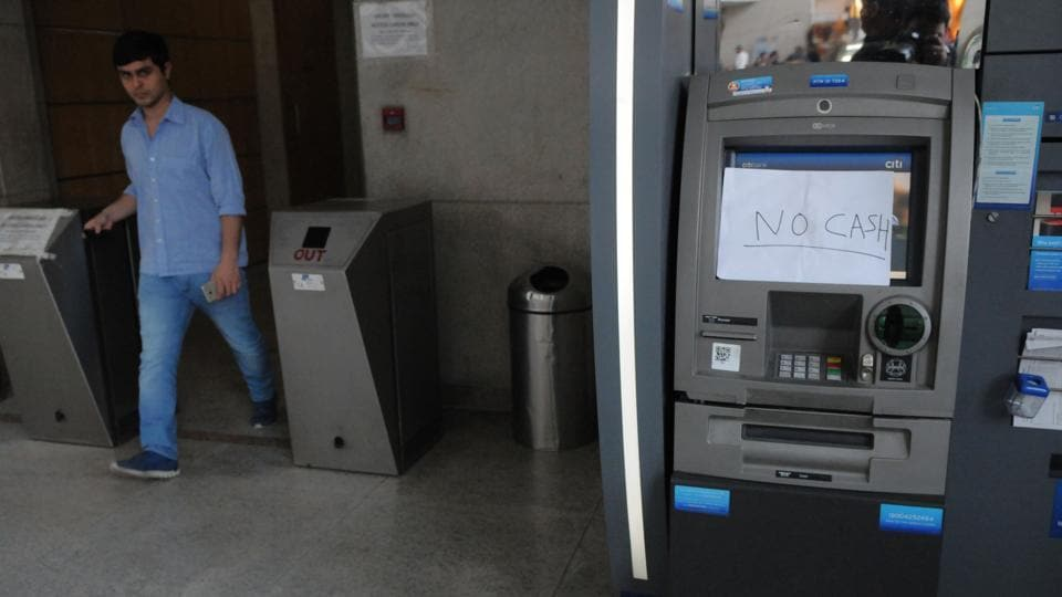 A 'no cash' sign on an ATM machine in Gurgaon.