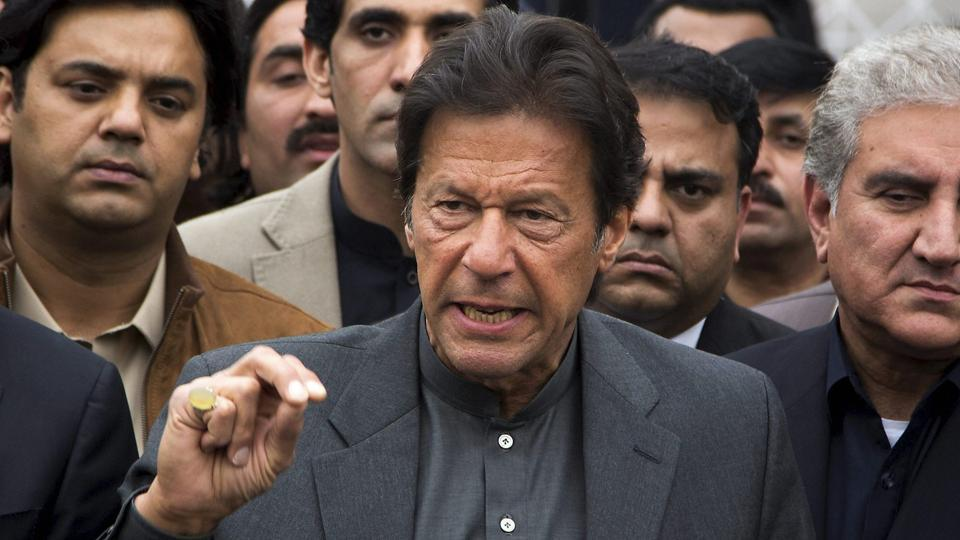 Former Pakistan captain turned politician Imran Khan talks to reporters outside the Supreme Court in Islamabad on Wednesday.