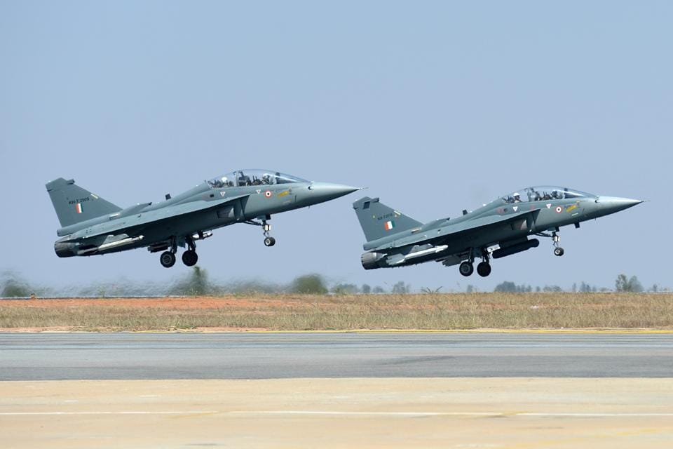 A pair of Tejas Light Combat Aircraft (LCA) take off during a display at the Aero India exhibition at the Yelahanka Air Force Station in Bengaluru on Wednesday.