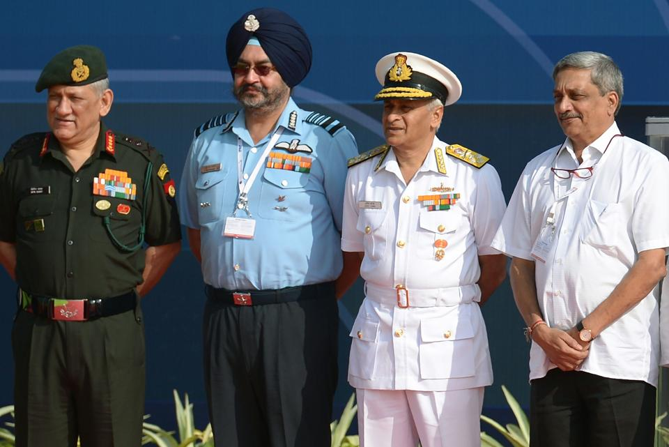 (Right to left) Defence minister Manohar Parrikar, Indian Navy chief Sunil Lanba, Indian Air Force chief Birender Singh Dhanoa, and Indian Army chief Bipin Rawat  at the Aero India biennial air show and aviation exhibition in Bengaluru on Tuesday.