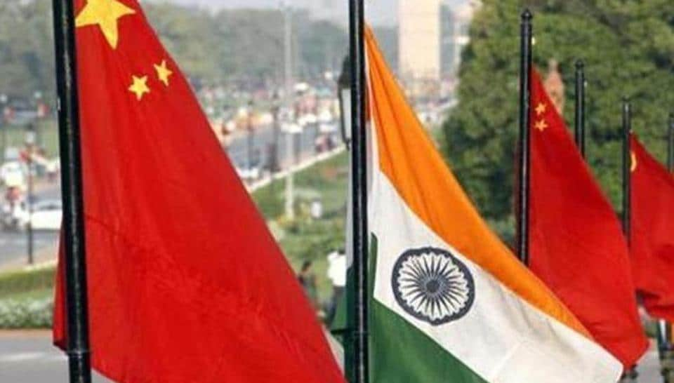The national flags of China and India at Vijay Chowk on Rajpath in New Delhi.