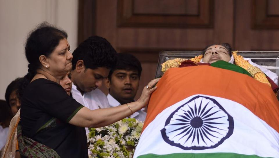 At J Jayalalithaa's funeral, VK Sasikala (left) and her family surrounded the body of the former chief minister.