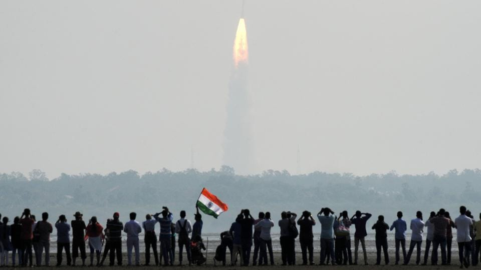 Indian onlookers watch the launch of the Indian Space Research Organisation (ISRO) Polar Satellite Launch Vehicle (PSLV-C37) at Sriharikota on Febuary 15.