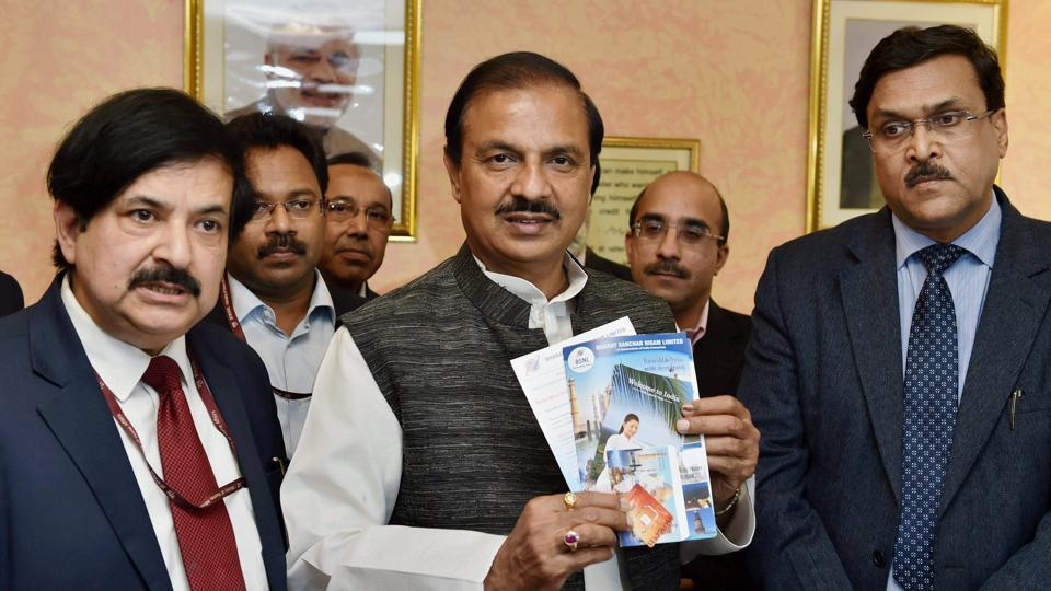 Tourism & culture minister Mahesh Sharma and other officials during the launch of the pre-loaded free SIM cards in New Delhi on Wednesday.