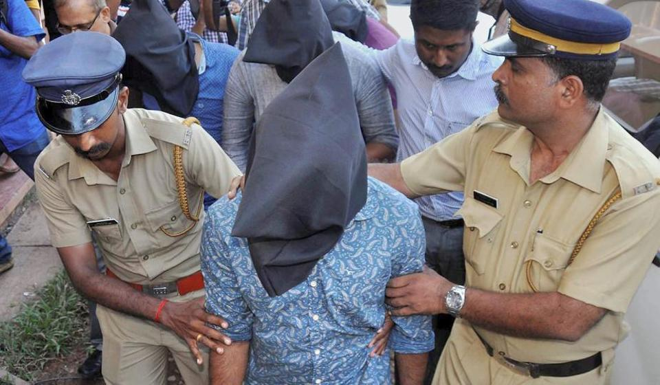 In this file photo from 2016, officers with the National Investigation Agency (NIA) produce the six men with suspected Islamic State (IS) links, before a NIA court in Kochi.