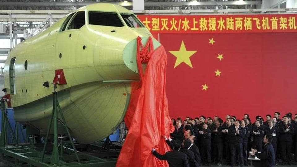 Officials of Aviation Industry Corporation of China (AVIC) unveil the newly-made nose of amphibious aircraft AG600, during a ceremony at a factory in Chengdu, Sichuan province March 17, 2015.