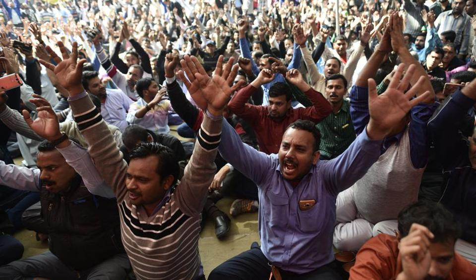Drivers of Ola and Uber shouting slogans against the app-based aggregators at Jantar Mantar on Wednesday.