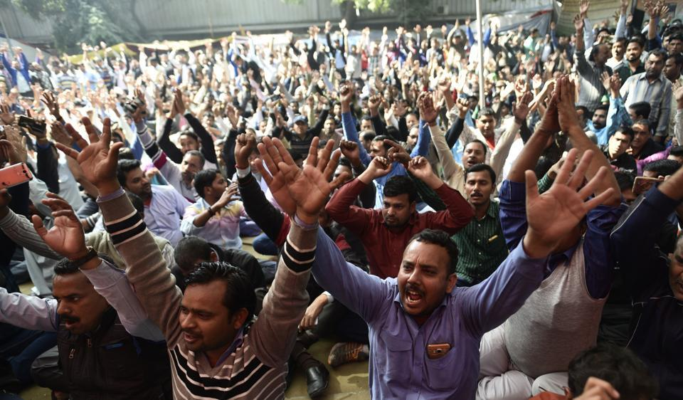 Drivers of Ola and Uber shouting slogans against the company as they are sitting on dharna at Jantar Mantar in New Delhi, India, on Wednesday, February 15, 2017.