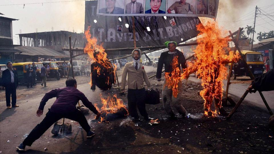 "Protesters burn effigy of Nagaland chief minister TR Zeliang and home minister Y Patton among others during a protest against the killing of two youth by security personnel last month, in Dimapur, Nagaland on February 7, 2017.  Nagaland enjoys special status under Article 371A which provides for protection of ""religious or social practices of the Nagas, Naga customary law and procedure, administration of civil and criminal justice involving decisions according to Naga customary law, ownership and transfer of land and resources""."