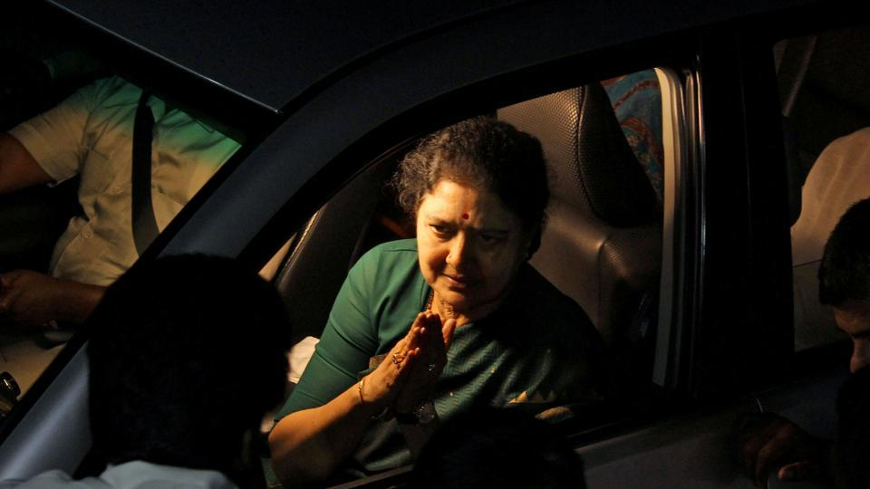 AIADMK general secretary VK Sasikala greets supporters as she leaves a resort at Kuvathur, in Chennai.