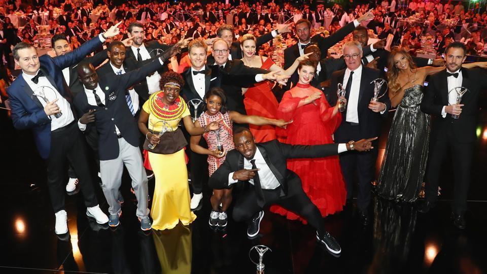 The winners of the Laureus World Sports Awards perform Usain Bolt's trademark celebratory move at the gala in Monaco on Tuesday. Bolt was adjudged the sportsman of the year while USgymnast Simone Biles won the sportswoman of the year award.