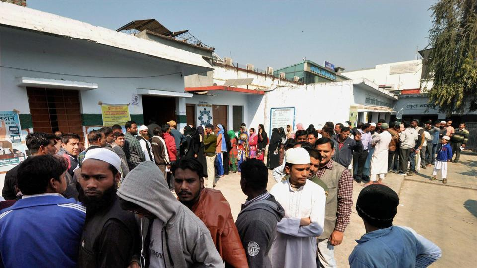 Voters queued up outside a polling booth to cast their votes at Dharampur constituency in Dehradun on Wednesday. Single-phase Assembly Elections in Uttarakhand started today.