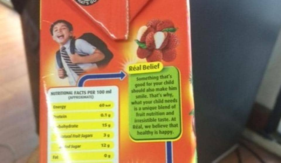 A part of the fine print on a juice pack addresses the male child, prompting a young girl to refuse the drink because it wasn't meant for her.