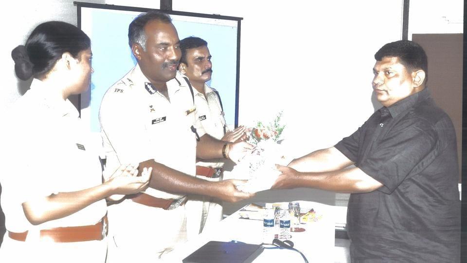 Shailesh Bhatt being felicitated by the police.
