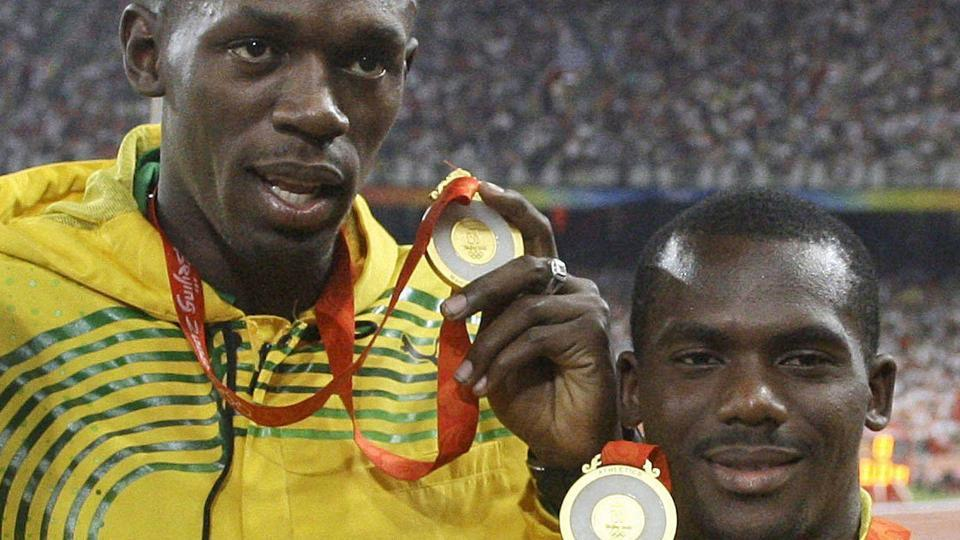Jamaica's men's 4x100 meters relay team members Usain Bolt, left, and Nesta Carter at the National Stadium during the Beijing 2008 Olympics.