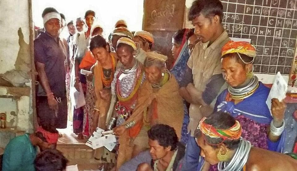 Women from Odisha's primitive Bonda tribe stand in a queue to exercise their franchise in the panchayat elections in Malkangiri district on Wednesday.