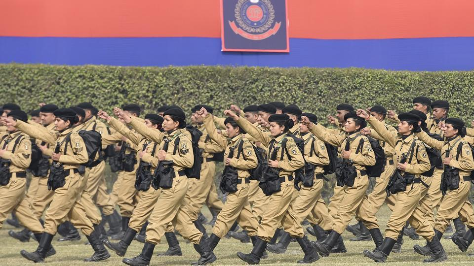 Delhi police women commandos march during the event.  While the number of women in the force is rising every year, there has not been a single female Commissioner of Police.  (Sonu Mehta/HT PHOTO)