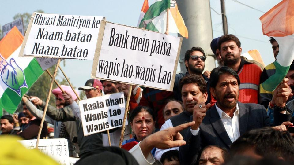 Party workers of the J&K Pradesh Congress Committee protest against Prime Minister Narendra Modi's demonetisation move in November 2016. PMModi said the note ban move was aimed at cracking down on black money. In this year's budget, finance minister Arun Jaitley also announced guidelines for political funding, meant to streamline cash flow in parties, considered a blind spot in the fight against black money.