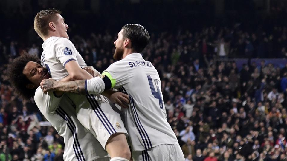 Real Madrid C.F's German midfielder Toni Kroos (centre) celebrates a goal with Marcelo (left) and Sergio Ramos during their UEFA Champions League round of 16 first leg match against S.S.C. Napoli at the Santiago Bernabeu stadium on Wednesday.