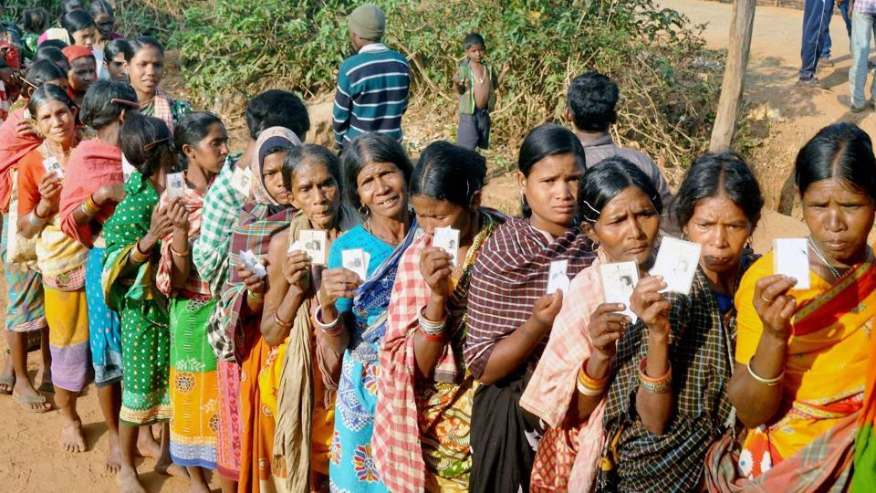 Tribal voters wait in queue to exercise their franchise in the Odisha panchayat polls in Kandhamal.