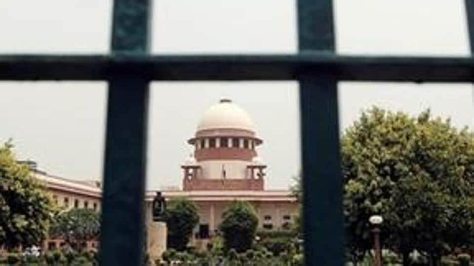 The Supreme Court is pictured through a gate in New Delhi.