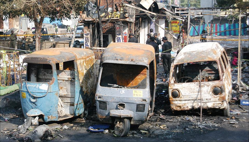 Burnt vehicles at the site of blast in Sarojini Nagar in 2005. Maximum casualties occurred in Sarojini Nagar.