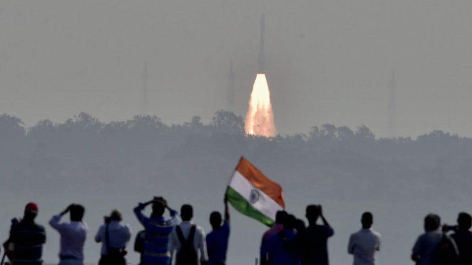 People watch as a rocket from space agency Indian Space Research Organisation (ISRO) takes off successfully to launch a record 104 satellites, including India's earth observation satellite on-board PSLV-C37 from the spaceport of Sriharikota on Wednesday, Feb 15, 2017.
