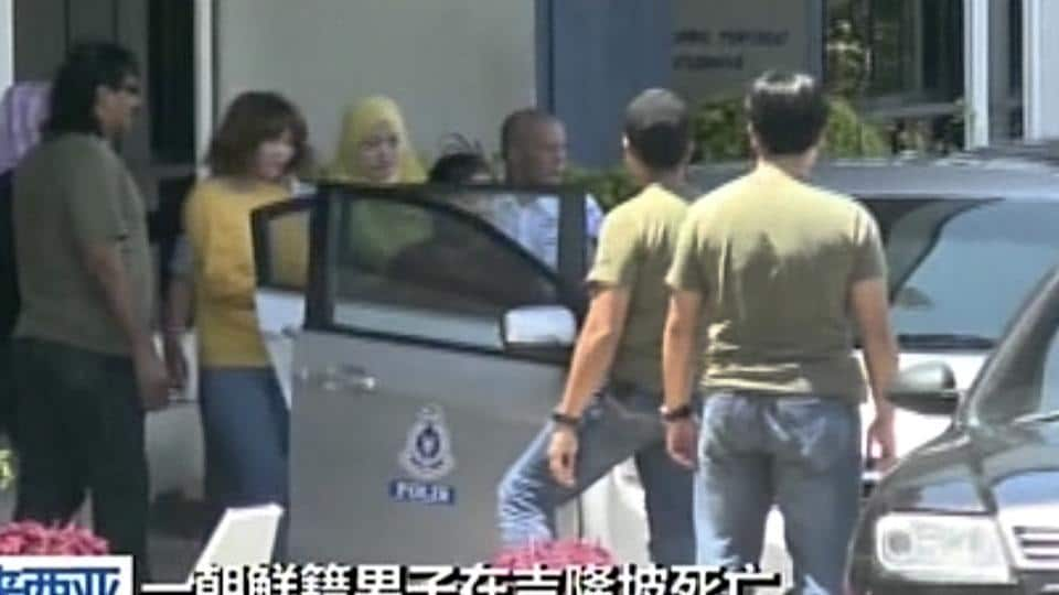 The woman (wearing a yellow top) suspected of involvement in the apparent assassination of Kim Jong Nam being escorted by Malaysian officials in Kuala Lumpur, Malaysia.
