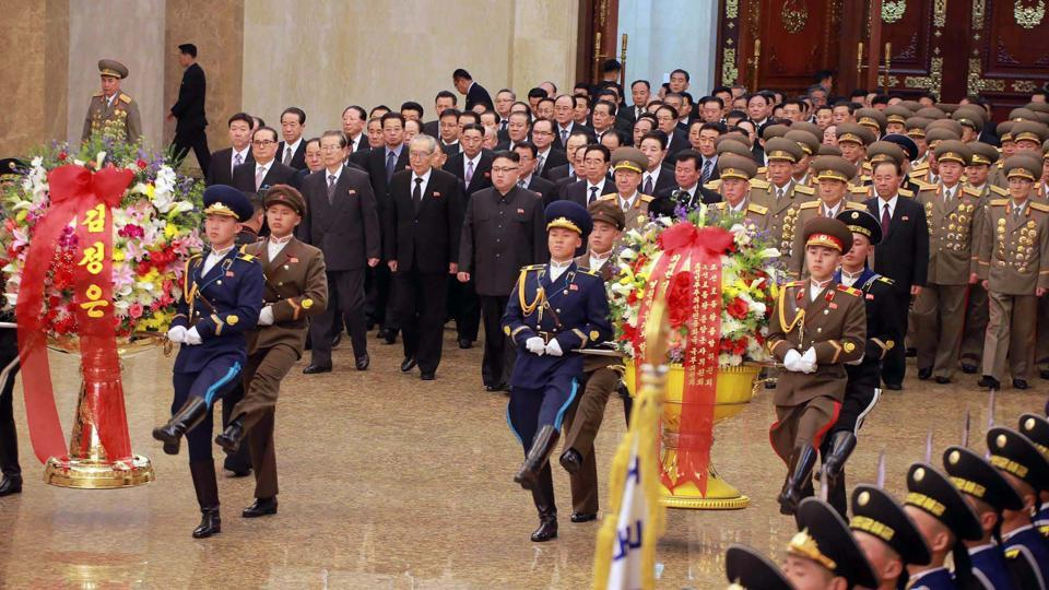 This picture taken and released by North Korea's official Korean Central News Agency (KCNA) on February 16, 2017 shows North Korean leader Kim Jong-Un (C) visiting the Kumsusan Palace of Sun in Pyongyang on the 75th birth anniversary of late leader Kim Jong-Il to pay tribute to him.