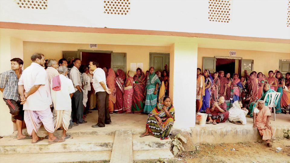 Voters queue in line to vote during the second phase of Odisha Panchayat polls at Balipatana village on Feb 15.