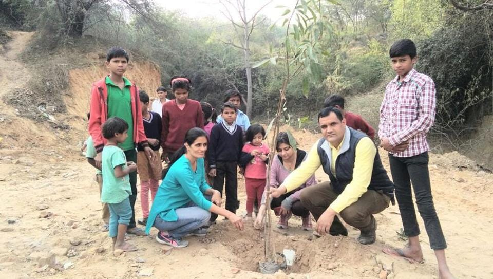 Residents of DLF Phase 1 conduct a plantation drive in Sikanderpur green belt area where as many as 40 trees were axed on Tuesday.