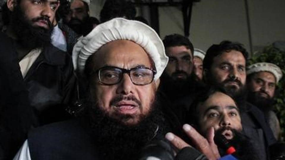 Hafiz Muhammad Saeed, the mastermind of 2008 Mumbai terrorist attack, speaks with media as he is escorted to his home where he will be under house arrest in Lahore, Pakistan January 30.