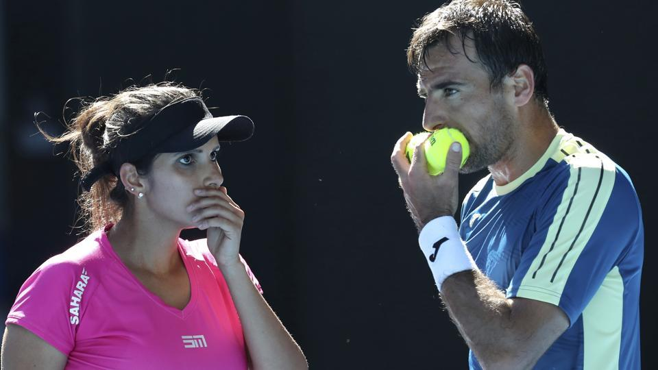 Sania Mirza and Ivan Dodig of Croatia talk tactics during their mixed doubles' final against Abigail Speers of the US and Juan Sebastian Cabal of Colombia at the Australian Open tennis championships in Melbourne.