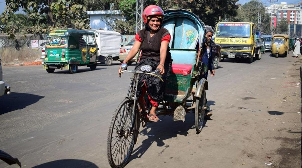 Bangladesh's lone female rickshawpuller Mosammat Jasmine poses on her battery-run rickshaw in Chittagong city on January 15, 2017.