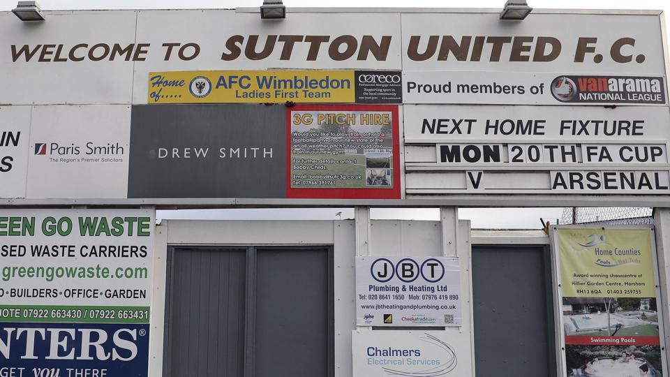 A sign advertising Sutton United's next fixture, which is against Arsenal FC on Monday at Gander Green Lane, London. Sutton United, the fifth-tier semi-professional team will play Arsene Wenger's Arsenal, the 13-time English champions, after reaching the fifth round of the FA Cup competition for the first time in its 118-year history.
