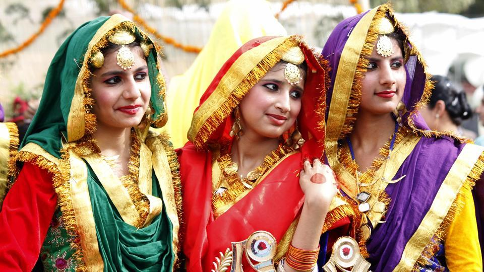Girls in traditional Punjabi attire during Rose Festival organised by UT administration in Chandigarh on Friday. (Sushil Prajapati/HT Photo)