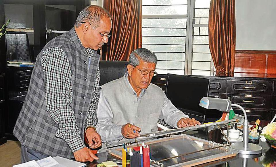 Chief minister Harish Rawat goes about with his work at his office in the state secretariat in Dehradun on Friday.