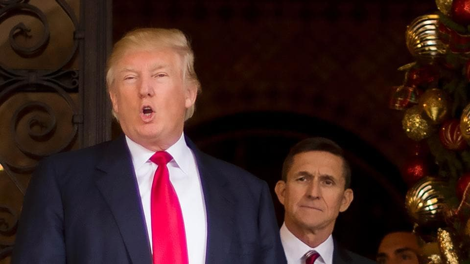 File photo of US President-elect Donald Trump with former NSA General Michael Flynn.