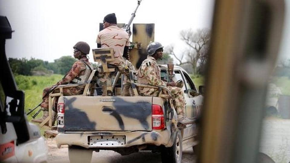 A Nigerian army convoy vehicle drives ahead with an anti-aircraft gun in Nigeria.