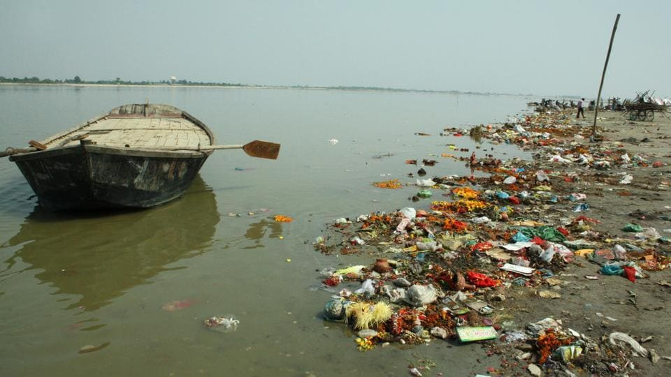 A man sits by the banks of a polluted Ganga. The pollution-control regime of UPis not capable of enforcing clear-air and clean-water laws, and attempts to do so have led to widespread protests.