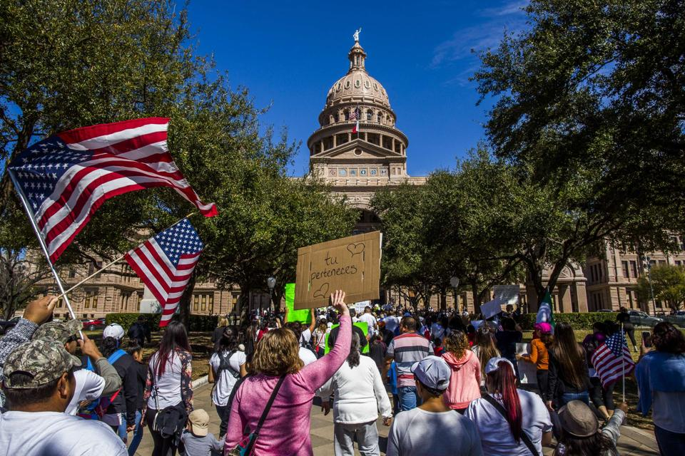 Protesters march in the streets outside the Texas State Capital on 'A Day Without Immigrants' February 16, 2017 in Austin.  Texas has become the first state to support President Trump's ban on travellers from seven Muslim-majority countries.