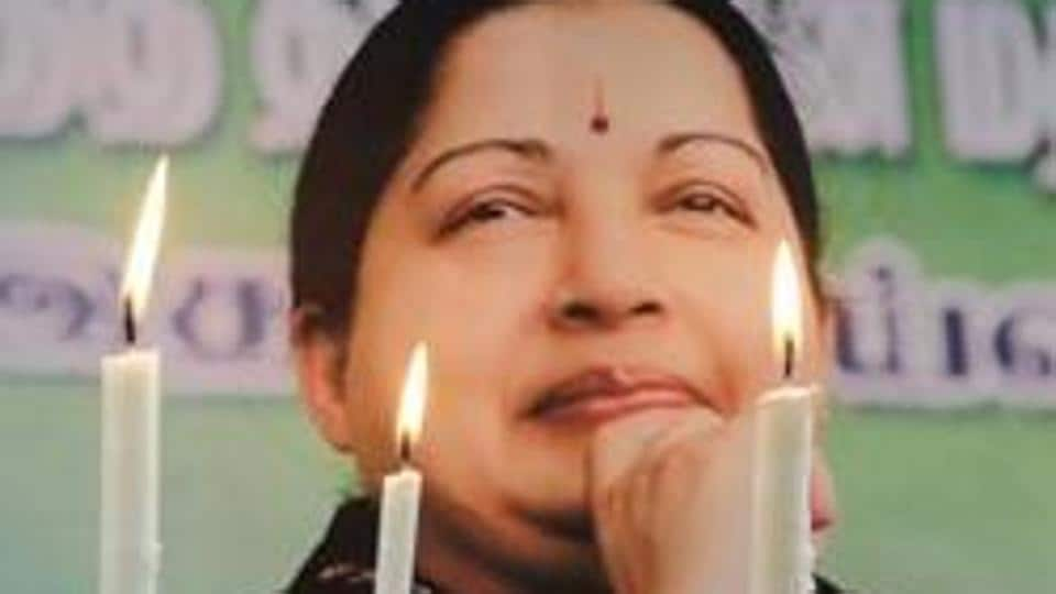 Supporters of the late Tamil Nadu chief minister J Jayalalithaa pay tribute a day after her death in December last year.
